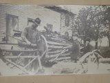 Grandpa working on the farm as a boy