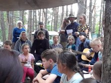 Two Monastic Fathers Sing at Campfire